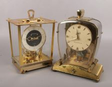 Two anniversary clocks, to include New Master and a Schatz electronic example.