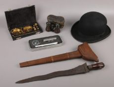 A group lot of collectables to include Bowler hat, sword in wooden sheath, boxed set of compass,