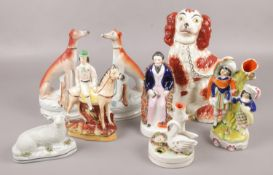 A collection of Staffordshire figures, to include pair of greyhounds, inkwell, recumbent sheep