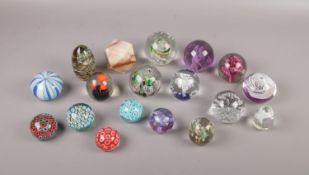 """A collection of mostly glass paperweights comprising of, A Caithness (Scotland) """"Moon crystal"""""""