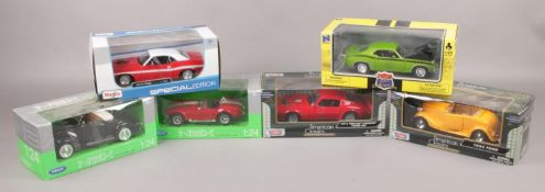 Six boxed diecast model cars, 1:24 scale, to include Maista, Motor Max, Welly Nex and New Ray.