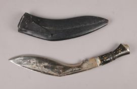 A Ghurkha Knife in sheave, embossed with inscriptions