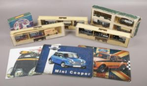 A collection of boxed Lledo Days Gone diecast model vehicles, along with three modern metal