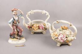 A Capodimonte ceramic figurine No 26, to include two large Capodimonte teapots Axe broken off
