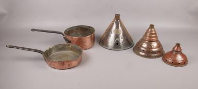 A collection of copperware comprising of, three copper washing dollies. One dolly is made by The