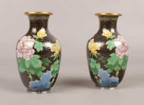 A pair of cloisonne vases, decorated with flowers. 14cm H.
