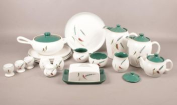 A quantity of Denby 'Greenwheat' pattern dinner and tea/coffee ware. Comprising of four