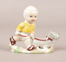 A Wade Mabel Lucie Attwell figure. Sarah with pet dog, Height 8cm.