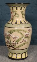 A large ceramic floral oriental style vase. H:52cm, Diameter: 23cm. Condition good. Not chips or