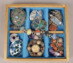 A box of Scottish costume jewellery. Including pebble and paste set examples etc.