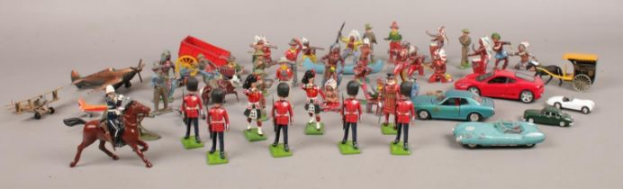 A collection of mainly vintage toy soldiers. To include Britains collectors figures, Corgi '