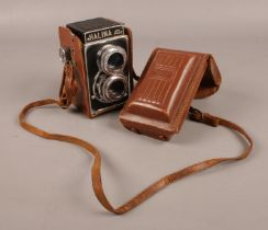 A Halina AI twin lens film camera in original case.