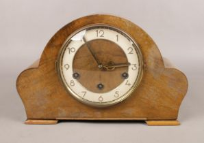 A carved Oak eight day dome top Westminster/Whittington chime mantle clock