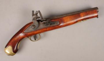 A carved hardwood and brass flint lock pistol. (approximately 40cm). Good condition. Action