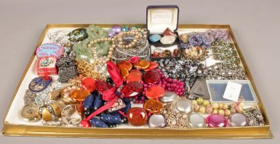 A large tray of costume jewellery to include necklaces, beads, etc.