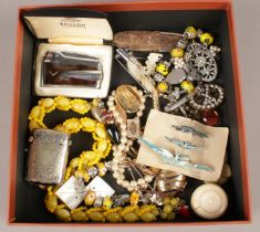 A box of mostly costume jewellery. Including Bluebird brooches, Ronson lighter, vesta, paw brooch,