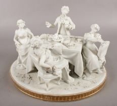 An early Sevres style bisque figure group depicting a dinner party, bearing inverted L symbol to