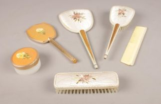 A group of dressing table accessories, hairbrush, hand mirror, clothes brush examples etc