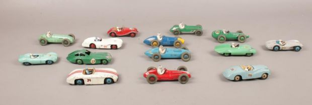 A group of 14 Dinky racing cars. Comprising 107 Sunbeam Alpine, 108 Midget, 239 Vanwell, 233