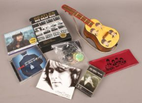 A collection of The Beatles related items. Includes pencil case, holographic medallions, CDs etc.