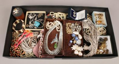 A tray of costume jewellery to include necklaces, bracelets, buttons, etc.