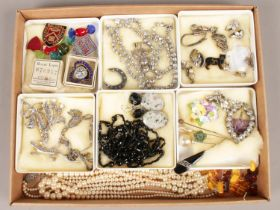 A tray of costume jewellery. Including medals, marcasite, paste stone examples, etc. Brooches in