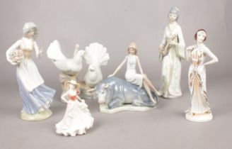 A collection of figurines. Coalport 'Birthday Wishes', Porceval Villamarchante White Doves, Norcroft