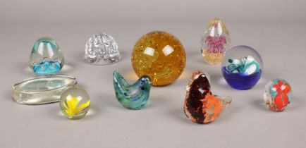 A group of glass paperweights. Various sizes and designs. (one boxed)