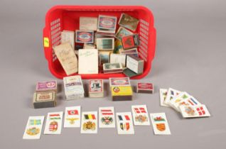 A selection of vintage match boxes (31), together with (approx. 64) player's cigarette cards of