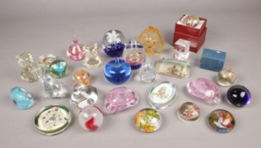 A collection of glass paperweights. Includes Little Red Riding Hood example, floral, animal etc.