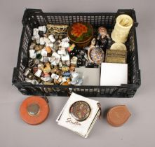 A box of collectables. Includes thimbles, buttons, Stratton compact, Wade etc.