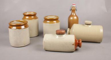 A group of Stoneware. Hot water bottle, storage jars examples etc