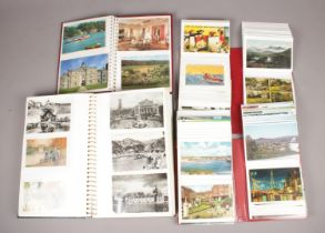 Four albums of colour and monochrome postcards. Includes vintage and humorous examples.