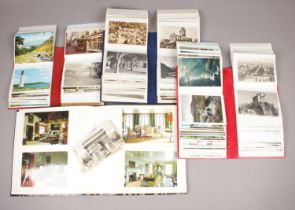 Four albums of colour and monochrome postcards. Includes vintage examples.