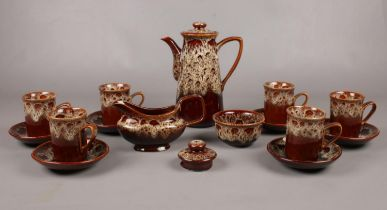 A Fosters Pottery Stoneware part coffee set. Coffee pot, coffee cups /saucer, milk jug examples etc