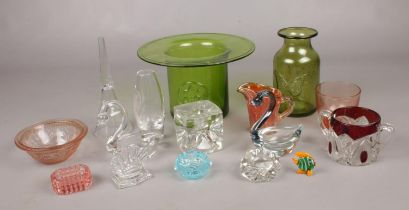 A collection of glassware. Includes green glass top hat vase, swan shaped dishes etc.