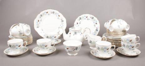 A Colclough tea service. Teapot, milk jug, sugar bowl, tea cups/ saucers, tea plates examples etc.