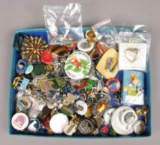 A collection of costume jewellery and pin badges.