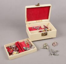 A Vintage Thoren's musical jewellery box. To include various brooches.