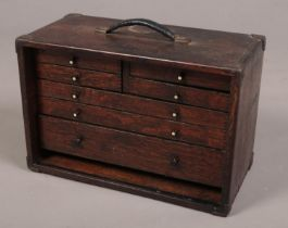 An oak Moore & Wright specimen chest. With metal mounted corners Missing front door.
