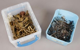 Two boxes of various clock keys.