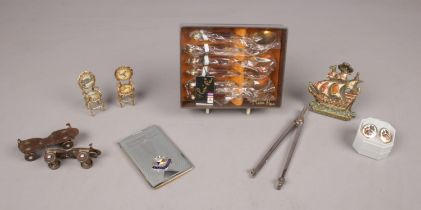 A small selection of collectables - comprising of a metal cased 'S.S Strathmore' shopping list