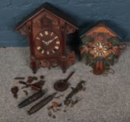 Two carved cuckoo clocks. In need of restoration.