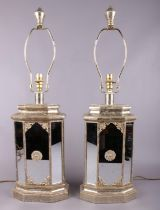 A pair of ornate hammered brass effect and mirrored table lamps. (69cm tall)