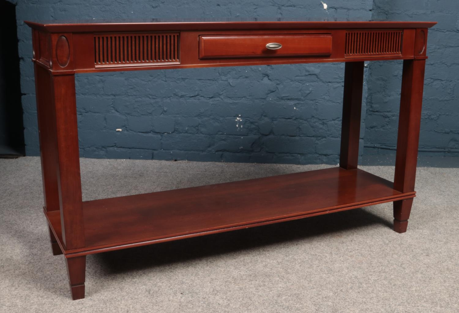 A Mahogany console table with central drawer. Made by (Theseira). H:71.5cm, W:120cm, Condition good.