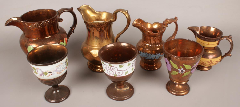 A quantity of copper lustre. Including goblets, jugs, etc.