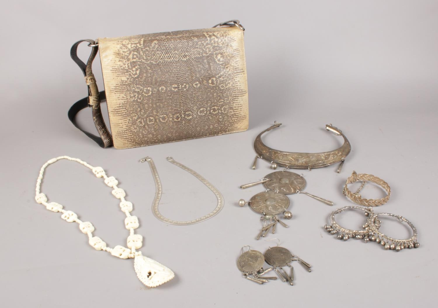 A group of costume jewellery & Python skin handbag. necklaces, earrings examples etc.