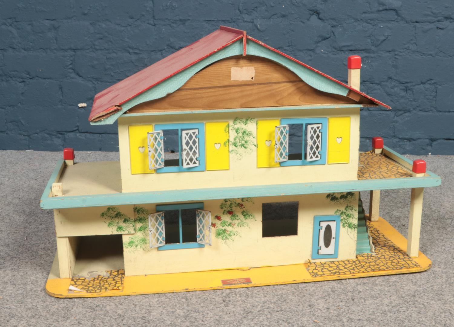 A Gee Bee Toys wooden dolls house. (68cm width, 42cm height, 29cm depth) Age/play worn