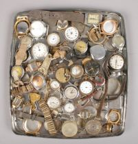A collection of watches and watch spares. Includes movements, cases, straps etc.