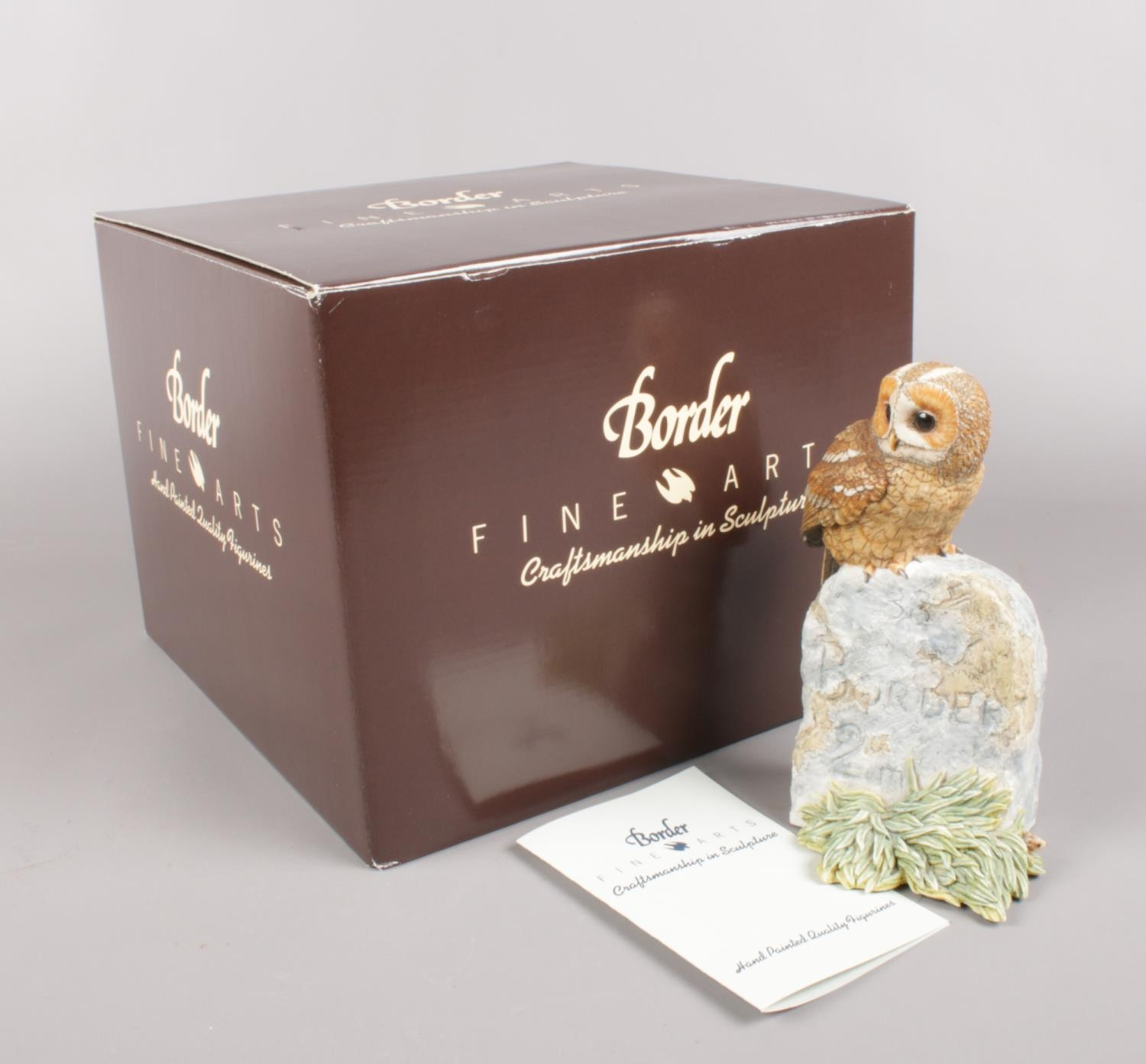 A boxed Border Fine Arts model by Ray Ayres, Tawny Owl on Milestone. Good condition.
